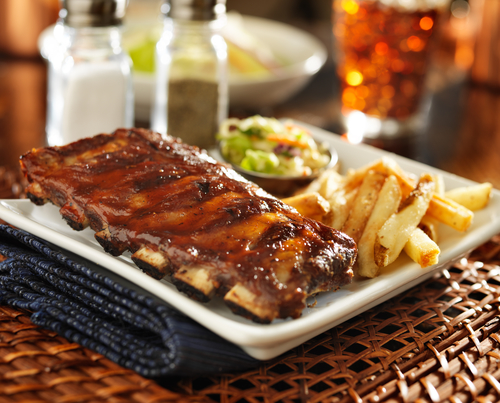 barbecue rib meal with cole slaw and french fries
